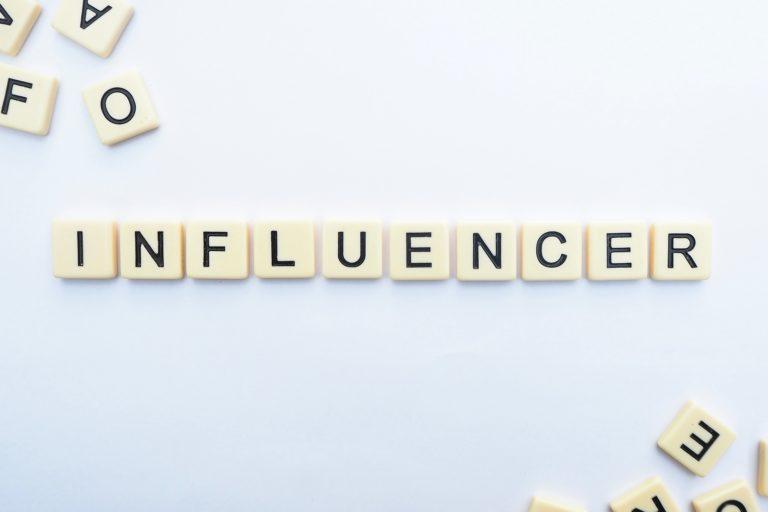 Influencer spelt in letter blocks