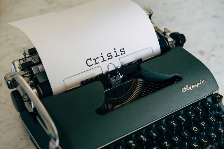 Crisis wrote on typewriter