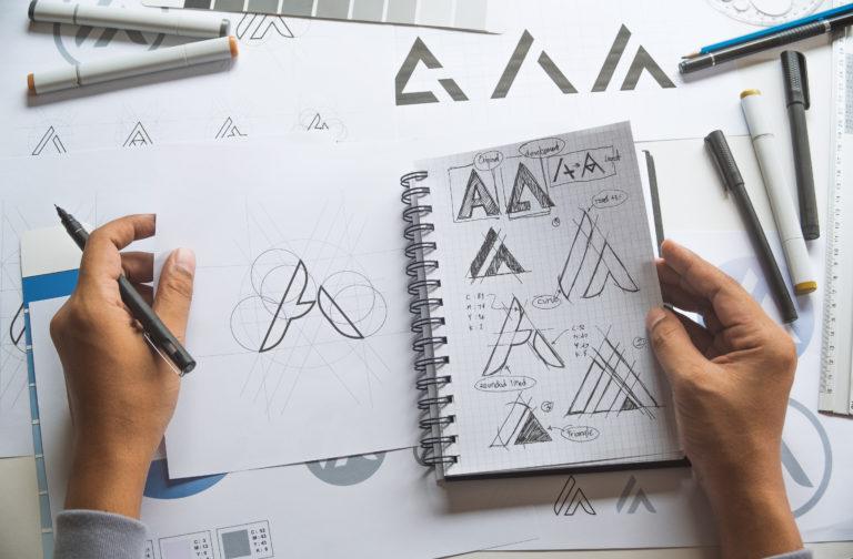 Graphic designer sketching a logo